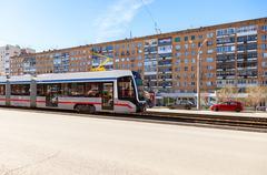 Samara public transport. New tram runs on the Lenin street in summer sunny da - stock photo
