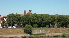 Pavia Skyline with San Michele Basilica and  Borromeo College behind trees, Stock Footage