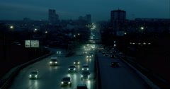 Metropolis. In big city heavy traffic . Evening city . 4k - stock footage