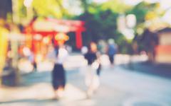 Abstract blurred tourists visit Fushimi Inari shrine in Japan - stock photo