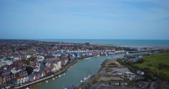 Littlehampton UK aerial of harbour and river estuary in West Sussex Stock Footage