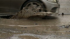 Cars in the city go around big holes. The condition of roads in Russian cities. Stock Footage