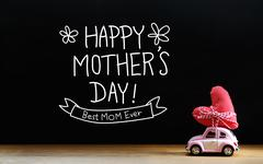Mothers Day message with miniature pink car - stock photo