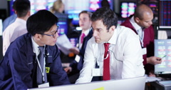 4K Busy room full of financial traders, watching world markets and doing deals - stock footage