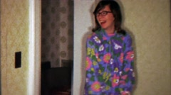 1967: Teenage girl hippy flower patterned fashion designer homemade clothes. - stock footage