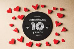 Anniversary 10 years message with small hearts Stock Photos