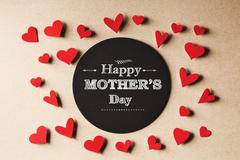 Happy Mothers Day message with small hearts - stock photo