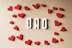 Felt Dad text with small red hearts - stock photo