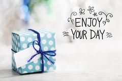 Enjoy Your Day message with gift box Stock Photos