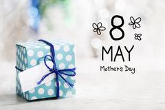 8 May Mothers Day message with gift box - stock photo