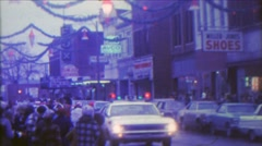 1967: Christmas parade small downtown city old timey storefronts. Stock Footage