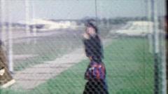 1968: Teenage girl 1st airplane flight outdoor boarding Ozark Airlines. Stock Footage