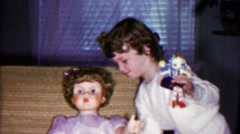 1958: Young girl has giant plastic toy doll trouble lifting heavy thing. Stock Footage
