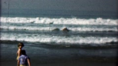 1958: Women early boogie board style body surfing inflatable mattress. Stock Footage