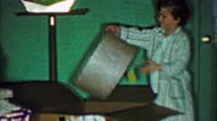 1958: Girl takes out 2 lamps from big box for Christmas gift. Stock Footage