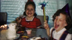 1958: Girl blows out birthday lamb animal cake candle party. Stock Footage