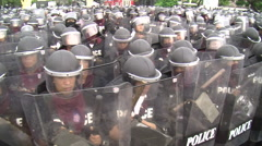 Riot Police in Full Combat Gear Confront Protesters Shields Body Armor 9592 - stock footage