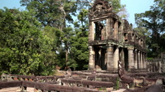 Preah Khan it is translated as A sacred sword. Trees and ruins of the temple - stock footage