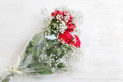 Colorful flowers bunch of red roses with alstroemeria and white gypsophila Stock Photos
