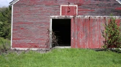 Front of an old abandoned red barn - stock footage