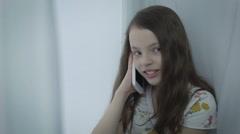 Beautiful little girl emotional talking on smart phone Arkistovideo
