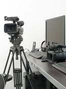 professional video camera and computer for edition - stock photo