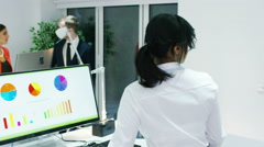 4K Business group watching business presentation on large screen - stock footage