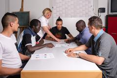 Language training for refugees in a German camp Stock Photos