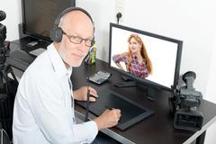 video editor in his studio - stock photo