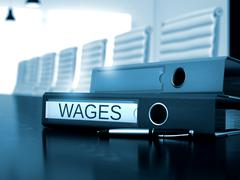 Wages on Folder. Blurred Image Stock Illustration