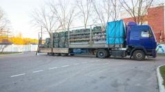 Loader fills a truck with pallets sorted waste. 4k timelapse Stock Footage