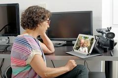 mom making a distant call on internet - stock photo