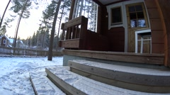 Girl Carries Firewood To The Woden Box On Porch In Forest Home And Enters House Stock Footage