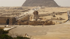 Pan Up -  Great Pyramids & Sphinx Daytime at Giza - Egypt Stock Footage