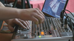 DJ working on a audiomixer at a nightclub Stock Footage