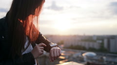 Woman using her smartwatch touchscreen device Stock Footage