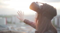 Woman uses a virtual reality glasses on the roof Stock Footage