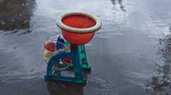 Toy water mill in the rain Stock Footage