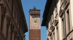 Majestic clock tower between eclectic palaces in Pavia, Italy Stock Footage