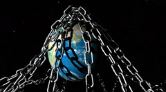 An animated planet Earth is rotating underneath various large metal chains. Stock Footage