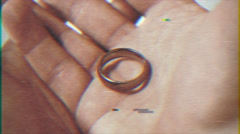 4k -  wedding ring in hand VHS effect with distortion - stock footage