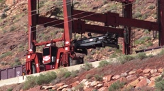 Lifting contaminated soil w/ crane, Moab, Utah Super Fund Clean up Stock Footage