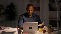 4K Tired businessman working late in modern office Stock Footage