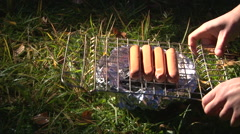 Put Sausages On A Barbecue Grille (For Hot Dogs) Stock Footage