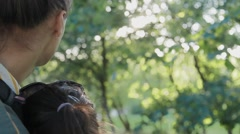 Loving couple, embraced, looking at summer park. Stock Footage
