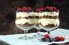 High fiber bran , yogurt and fruit sundaes. - stock photo