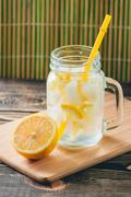 Lemonade with Fresh Lemon. Healthy Food and Drink Concept - stock photo