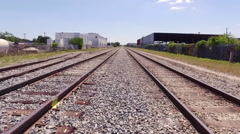 Train Tracks with blue skyline slow motion with track switch Stock Footage