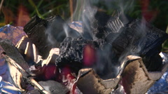 Coals burning flame in handmade brazier, close up shoot Stock Footage