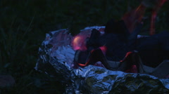 Coals burning in handmade brazier in the dark night, close up shoot Stock Footage